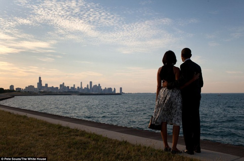 Loving husband: The President and First Lady look out at the city skyline and Lake Michigan after arriving at the Burnham Park landing zone in Chicago
