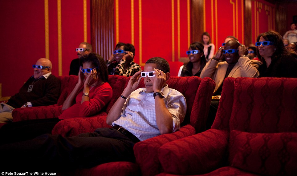 Downtime: President Barack Obama and First Lady Michelle Obama wear 3-D glasses while watching a TV commercial during Super Bowl 43, Arizona Cardinals vs. Pittsburgh Steelers, in the family theater of the White House