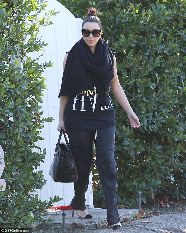 Feeling chilly? Kim teamed her black ensemble with a large black scarf
