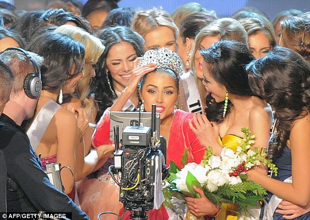 Swarmed: Miss Culpo is surrounded by contestants after being crowned Miss Universe 2012