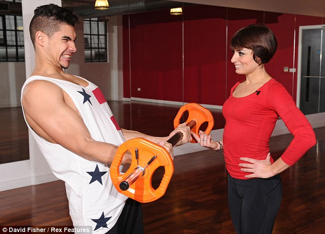 Do you need some help their Louis: Flavia smiles as Louis grimaces during his weight-lifting session