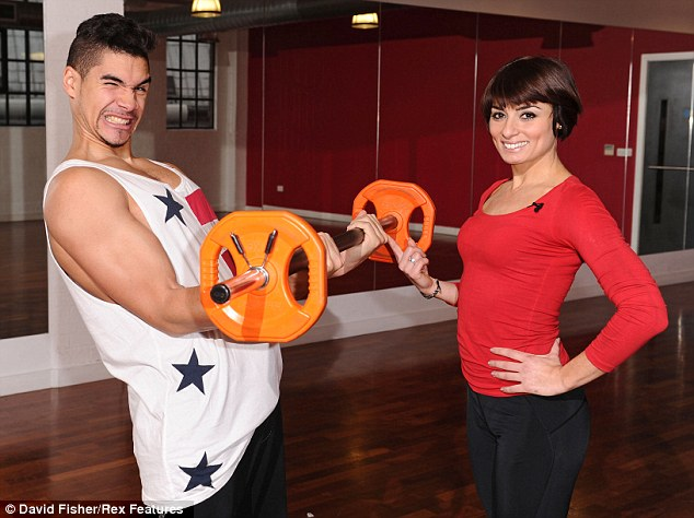 Work it out: Louis Smith lifts some weights during a break in dance rehearsals with Strictly Come Dancing partner Flavia Cacace