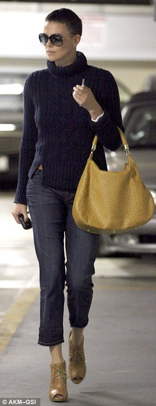 Boyish look: The Promethius actress wore a boxy blue turtleneck and loose cropped jeans