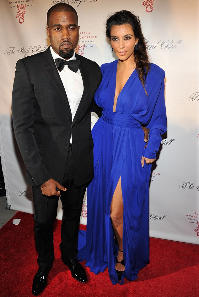 Moving on: Although she is still legally married to Humprhries, Kim has moved on with boyfriend Kanye West, pictured with the TV star on October 22