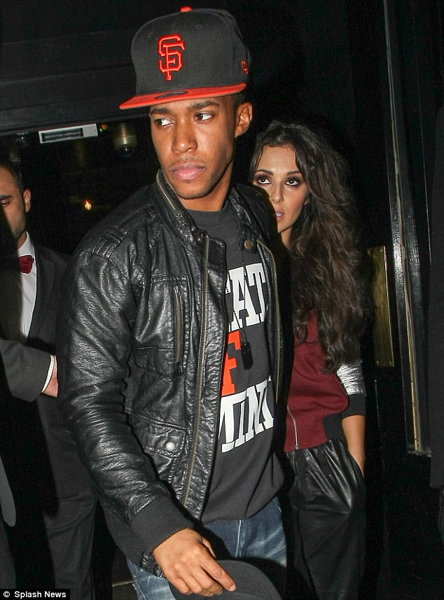 Doting boyfriend: Cheryl was led out of the nightspot by Tre