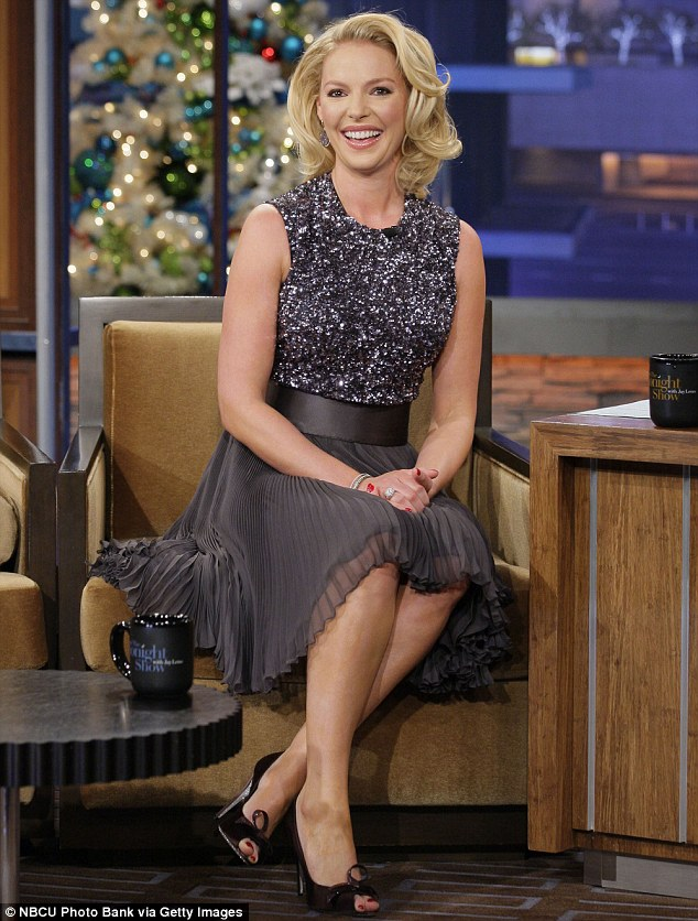 Elegant: Katherine showed off her tiny waist in her striking grey pleated dress as she sat down for a chat with host Jay Leno