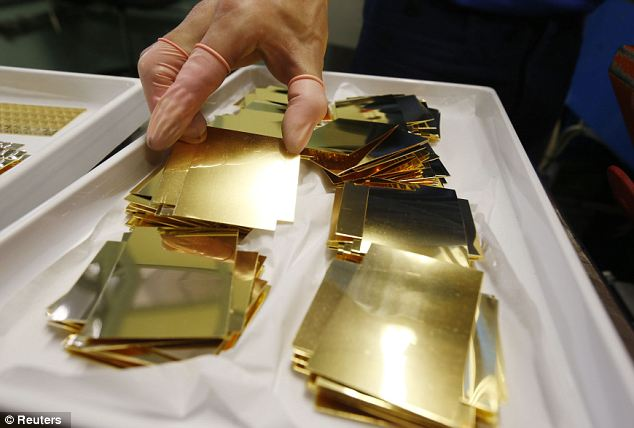 Gearing up for the Christmas rush: A Valcambi employee holds an unpressed gold Combibar