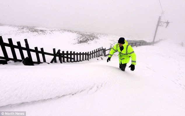 White Christmas: Snow piled up across the North Pennines, where Andrew Heatherington checked the ski tow at a ski-slope in Cumbria
