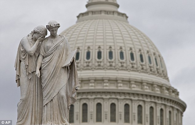 Gray skies cover the U.S. Capitol in Washington as Congress closes down for the holiday without a compromise on the 'fiscal cliff'