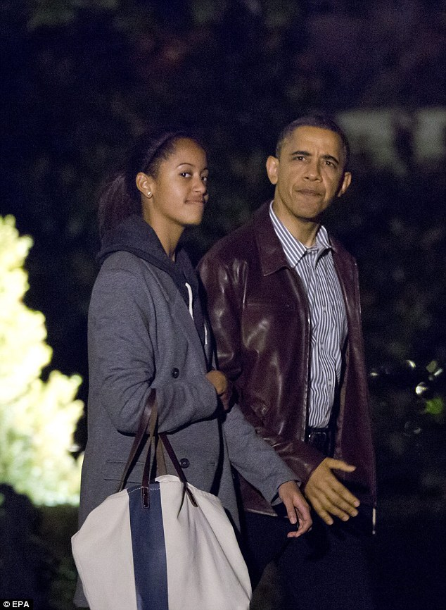 Festive Spirit: U.S. President Barack Obama and his daughter Malia depart the White House for a Christmas vacation in Hawaii