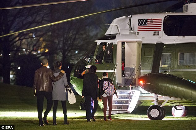 Merry Christmas: U.S. President Barack Obama his daughter Malia First Lady Michelle Obama and daughter Sasha (right) depart the White House for a Christmas vacation in Hawaii