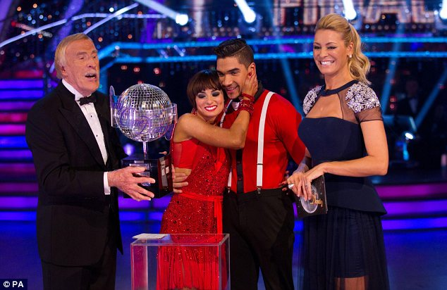 Hugging out it: Flavia, who has been in the final of the dancing show before, seemed delighted to finally be lifting the Glitterball