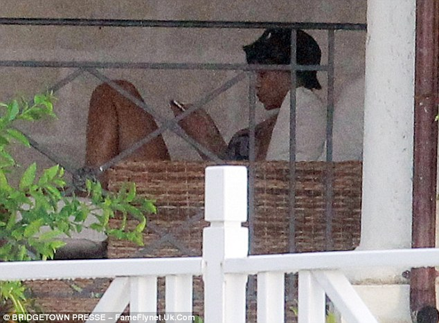 It's a hard life: The hit maker takes a little rest after showing off her curves on the balcony of her swanky pad