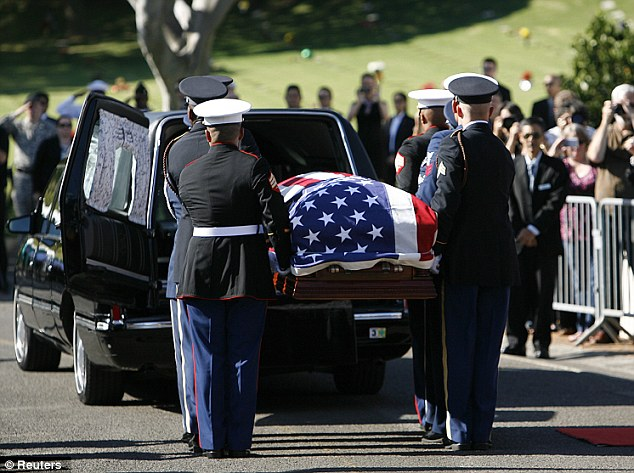 Honor guard: The casket of Senator Inouye is removed from the hearse for his memorial ceremony after it arrived at the National Memorial Cemetery of the Pacific at Punchbowl in Honolulu