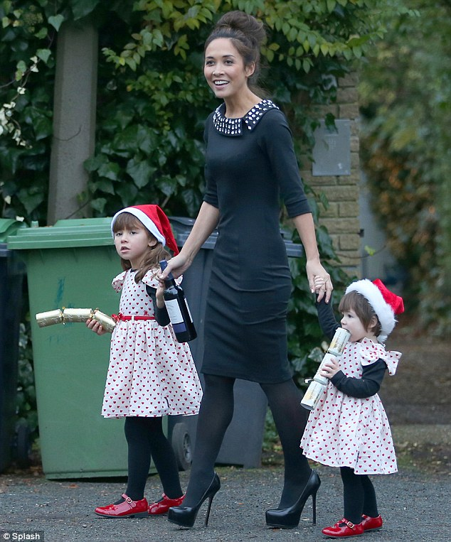 The leader of the pack: Myleene dressed in all black as her daughters wore matching white and red frocks