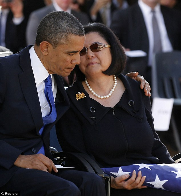 Comforter-in-chief: Obama hugs Irene Hirano Inouye, widow of the late U.S. Senator Daniel Inouye, after she receives the flag that draped his casket at the memorial service