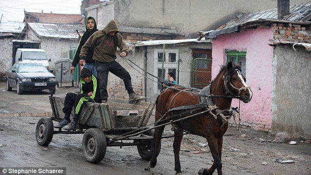 Three men ride a horse and carriage around Faculteta, Bulgaria. Many from the town have already moved to England
