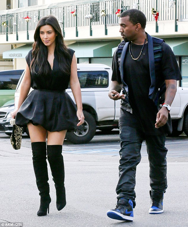 You look good! Kanye West eyes up Kim Kardashian as they head out of Chin Chin Restaurant in Downtown Los Angeles