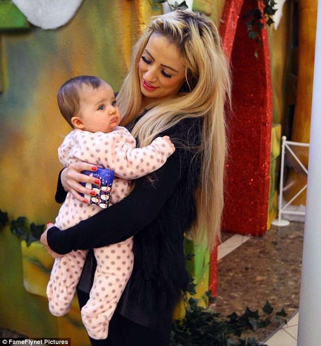 Have a holly Dolly Christmas! Chantelle Houghton braved Lakeside shopping centre in Essex on Christmas Eve to treat her daughter to a meeting with Santa Claus