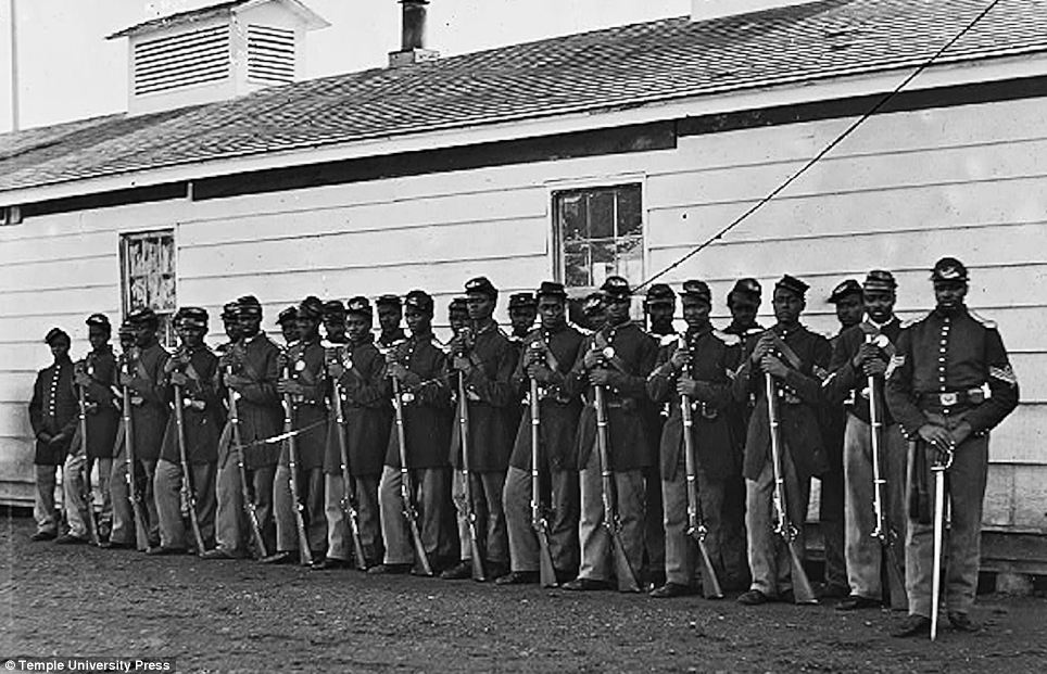 Smart: The caption reads: 'District of Columbia, Company E, Fourth U.S. Colored Infantry, at Fort Lincoln'. The image was taken between 1862 and 1865