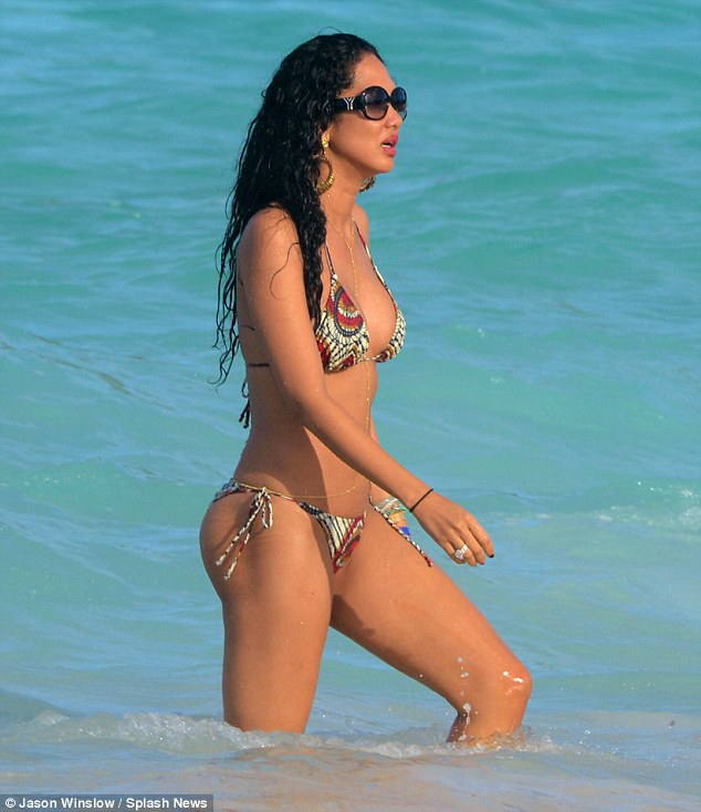 Holiday time: Kimora shows off her model figure in the sea