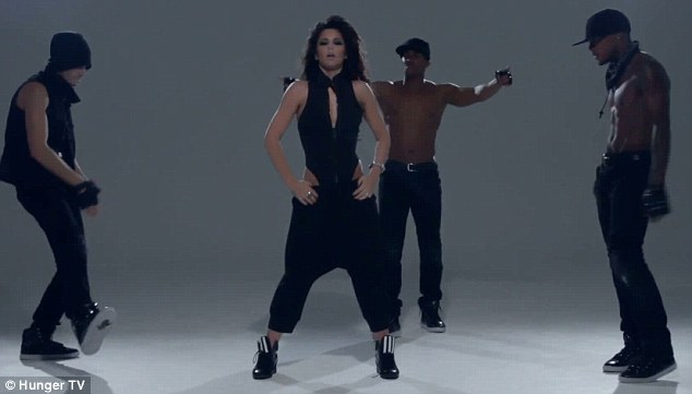 Dancing queen: Tre isn't the only male dancer in the video, however, and Cheryl is also flanked by two other muscular hunks