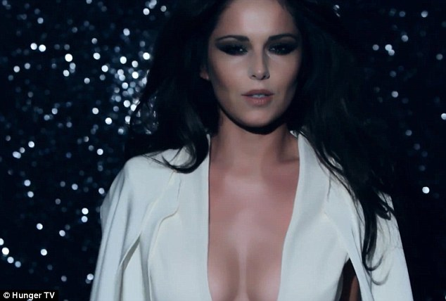All white on the night: In another frame, Cheryl shows off her figure in a plunging white dress