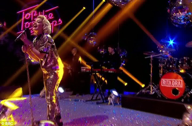 Gorgeous in gold: Rita Ora wore a black and gold two-piece for her performance of How We Do