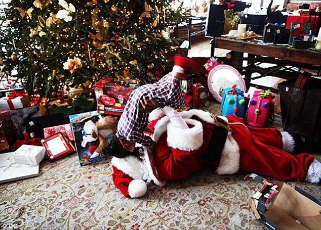 Santa was good to Dem Babies: Among the numerous Christmas presents visible on the floor were two luggage trollies, an Etch-A-Sketch, and a toy truck