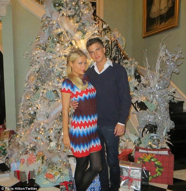 Paris Hilton Poses With Toyboy Lover Next To Christmas