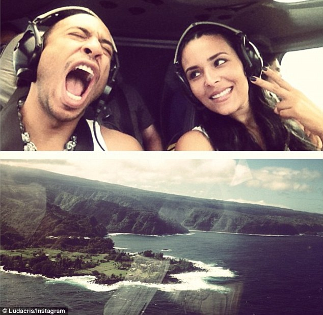 Flying away: Ludacris pretended to scream while in a helicopter with his beautiful girlfriend