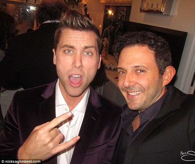 Rocking out: Also seen toasting the Kardashians and Jenners was former boybander Lance Bass, flashing the devil horns hand gesture