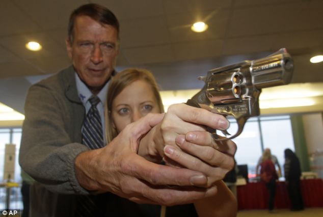Cori Sorensen, a fourth grade teacher from Highland Elementary School in Highland, Utah, receives firearms training with a .357 magnum from personal defense instructor Jim McCarthy during concealed weapons training for 200 Utah teachers