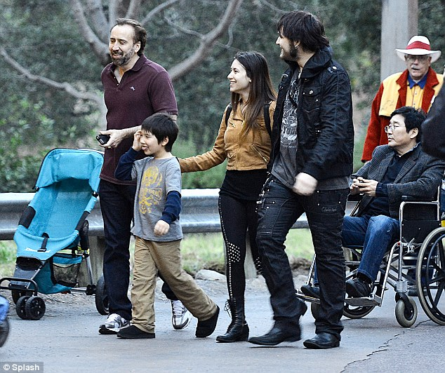 Family fun day: Nicolas Cage seemed to be having a whale of a time as he enjoyed a day out with his sons Weston, 22, and Kal-El, seven