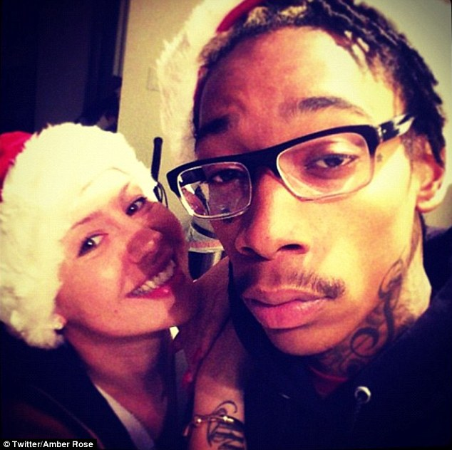 'Little Elf': Amber posted this adorable snap of her and Wiz Khalifa on her Twitter page on Christmas Day