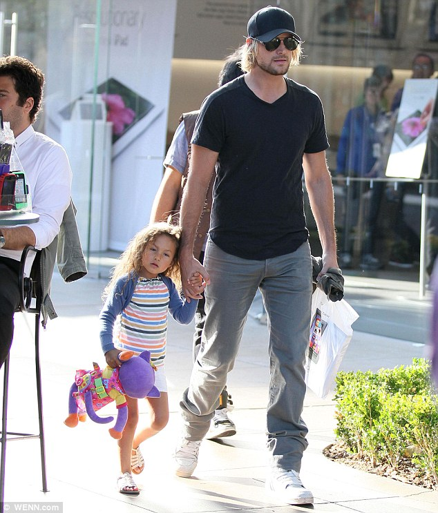 Home in L.A.: Nahla held her dad, Gabriel Aubry's hand, as they walked around The Grove in Los Angeles back in March