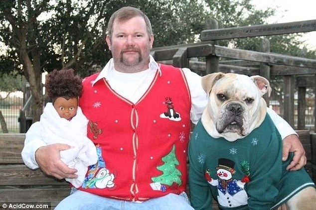 It takes all sorts: As this rather unusual picture proves. We're not quite sure what's going on with the doll, or the Christmas jumpers for that matter