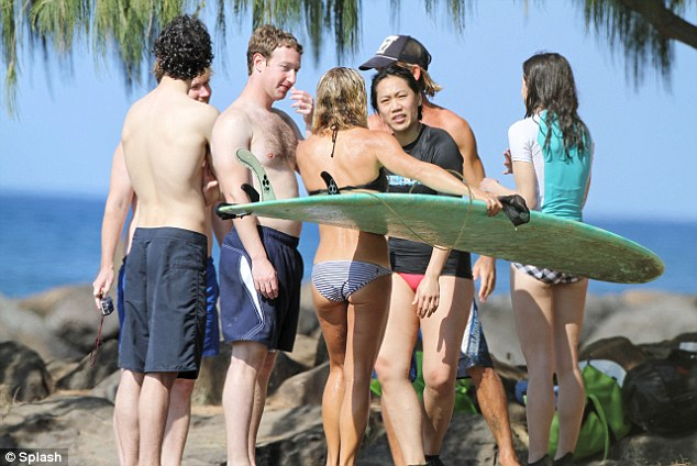 Social networking: The Zuckerbergs, who married in May, chat with fellow surfers on the Hawaiian beach