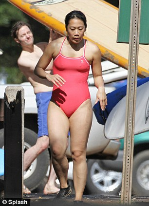Relaxing: Mrs Zuckerberg, 27, enjoys the balmy temperatures of Hawaii in a one-piece, sporty red swimsuit