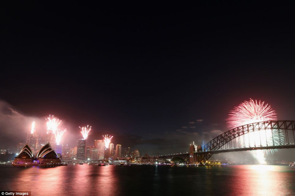Fireworks light up the sky during the New Year celebrations at Sydney Harbour
