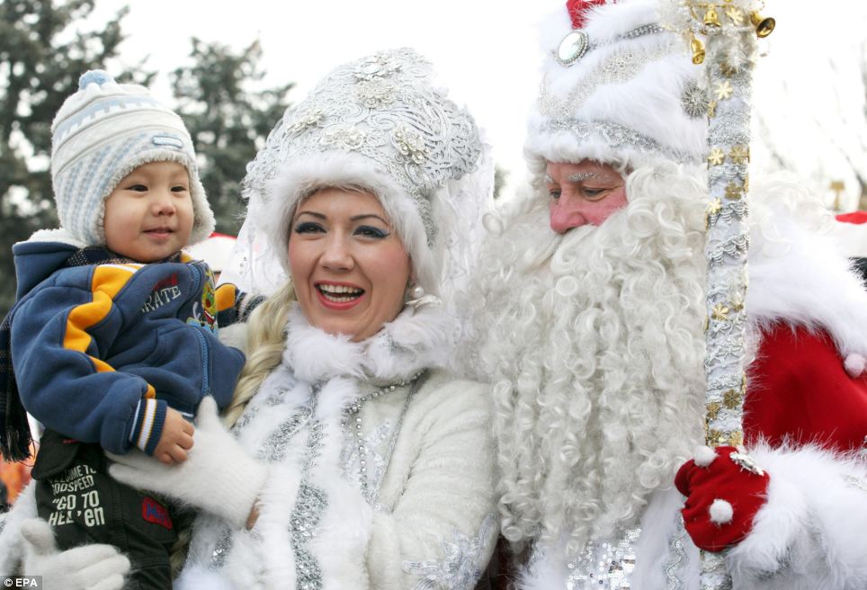 Father Frost (right) and his granddaughter (centre) take part in a New Year parade in Bishkek, Kyrgyzstan. Father Frost is the Slavic culture equivalent of Santa Claus