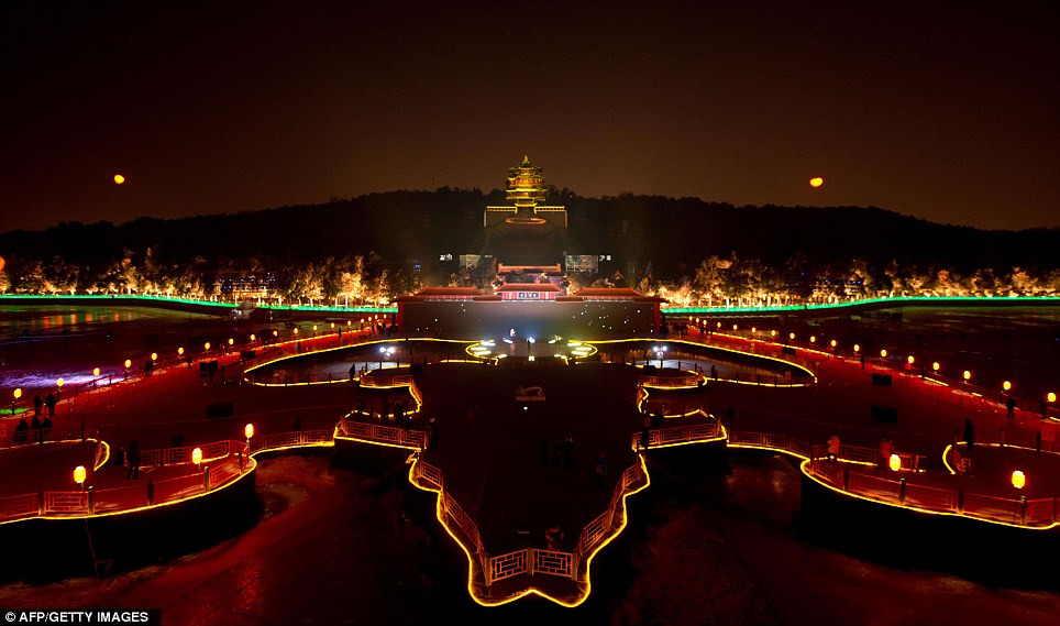 Incredible: A stunning lightshow illuminates the Summer Palace during a new year countdown event in Beijing