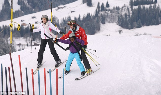 Still learning: The cute youngster stood out in her vibrant skiing outfit over the weekend