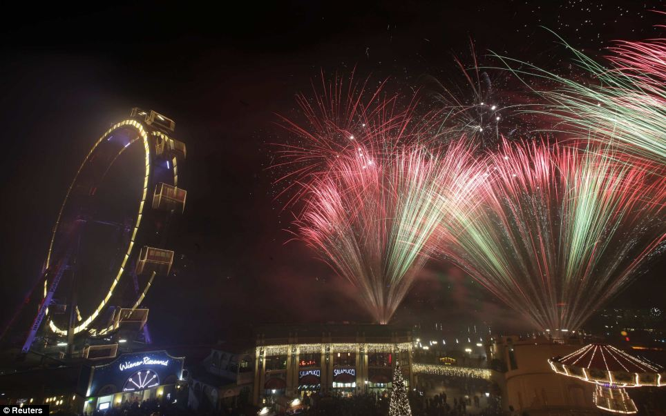 Fireworks explode beside Vienna's giant ferris wheel Wiener Riesenrad at Prater park during New Year