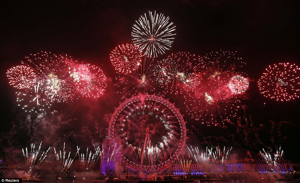Bright: Fireworks explode around the London Eye during New Year's celebrations in central London