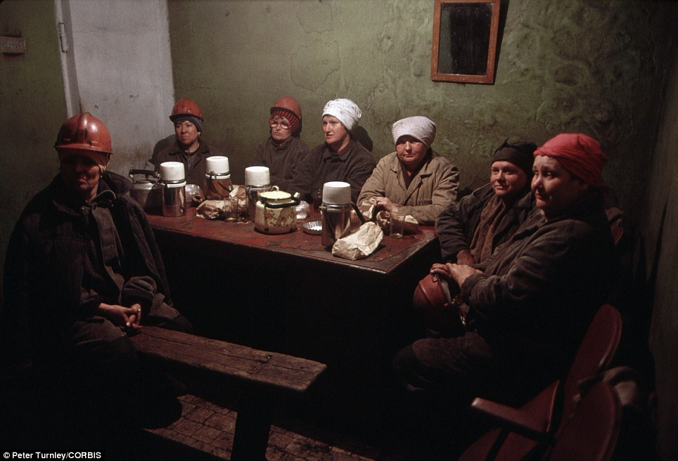 No smiles: Female miners take a break from their work in the town of Novokuznetsk, Russia, in June 1991