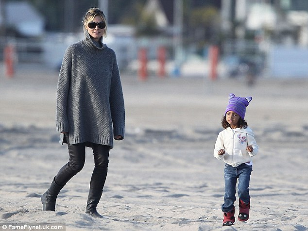 Chic: The 39-year-old looked stylish in leather leggings and an oversize grey jumper