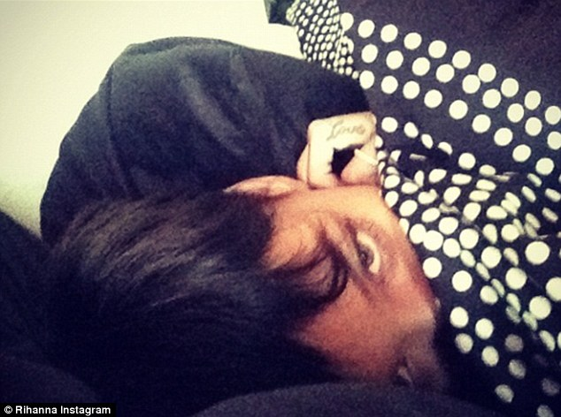 Slick: 'Good morning! Still haven't slept lol #hello2013,' Rihanna tweeted with this photo on Tuesday