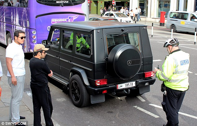 Not impressed: A Mercedes 4x4 in central London is given a ticket in a scene from the new documentary