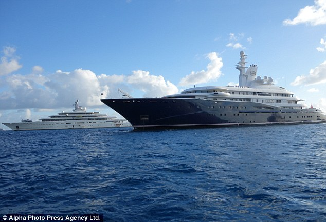 Battle of the super yachts: Billionaire Roman Abramovich got to size up the competition after anchoring his white ship Eclipse (back) next to the Al Mirqab owned by the Emir of Qatar Hamad bin Jassim bin Jaber Al Thani